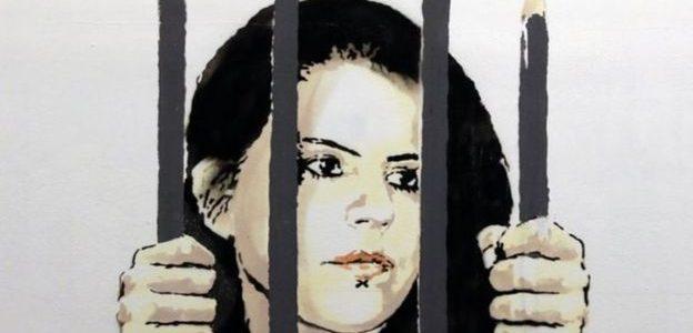 لوحة عملاقة لبانكسي في نيويورك دفاعا عن رسامة خلف القضبان في تركيا