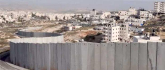 سجن فلسطيني وعائلته لتثبيته جرساً على الجدار