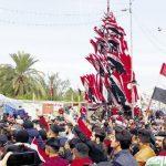 محتجون يقطعون طرقا رئيسية وتجارية وسط كربلاء بالعراق