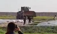 جيش الاحتلال الإسرائيلي ينكل بجثمان شاب في غزة .. قتلوه وعلقوه بجرافة